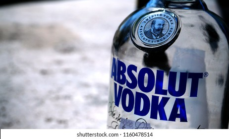 Rome, Italy - July 15, 2018: Empty bottle of famous Swedish vodka Absolut Vodka with blurred background