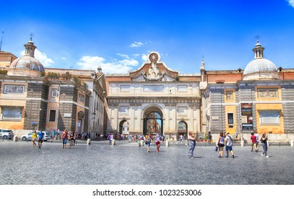 ROME, ITALY - JULY 16, 2017: Cityscape with tourists on Piazza del Popolo (People's Square) in Rome, Italy. The Piazza is a large urban square in Rome (13,500 m2 approx, about 150 m by 90 m)