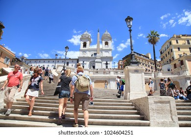 ROME, ITALY - JULY 16, 2017: Tourists in Piazza di Spagna, on the Spanish Steps (Scalinata di Trinita dei Monti), Rome, Italy