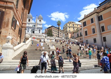 ROME, ITALY - JULY 16, 2017: Tourists in Piazza di Spagna, on the Spanish Steps(Scalinata di Trinita dei Monti), Rome, Italy