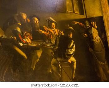 "ROME, ITALY - JULY 26, 2018: The famous painting by Caravaggio ""The Calling of St. Matthew"" (Italian: La vocazione di San Matteo) in the San Luigi dei Francesi church."