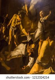 ROME, ITALY - JULY 26, 2018: The Martyrdom of St. Matthew (Italian: Martirio di San Matteo) by Caravaggio in the Contarelli Chapel, San Luigi dei Francesi church.