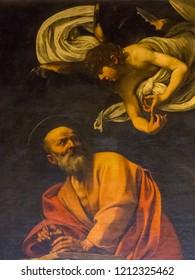 ROME, ITALY - JULY 26, 2018: The Inspiration of St. Matthew (Italian: San Matteo e l'Angelo) by Caravaggio in the Contarelli Chapel, San Luigi dei Francesi church.