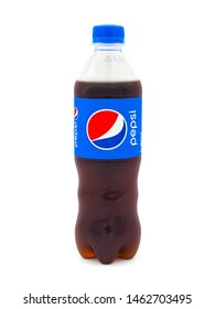 ROME, ITALY - JULY 27, 2019. Classic bottle of Pepsi isolated on white background. Pepsi is a carbonated soft drink manufactured by PepsiCo.