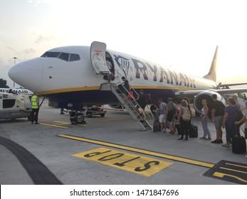 Rome, Italy - July 27, 2019: Passengers boarding on Ryanair Jet airplane in Rome Ciampino Giovan Battista Pastine Airport. Ryanair Ltd is an Irish low-cost airline