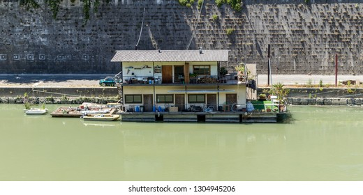Rome, Italy - July 3, 2017: Houseboat on Tiber River in Rome, Italy