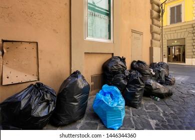 Rome, Italy - July 3, 2019: the garbage emergency in rome involve even the popular luxury area via Condotti