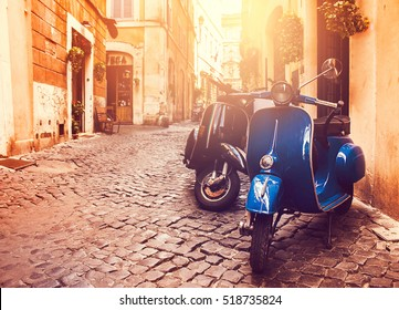 Rome, Italy - July 8, 2014: Two Scooter Vespa parked on old street in Rome, Italy