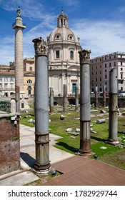 ROME, ITALY - JUNE 1, 2019: Trajan Forum, Roman square ruins. Trajan's Column monument and the Church of the Most Holy Name of Mary in background.