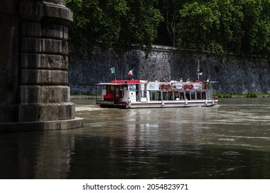 ROME, ITALY - JUNE 1, 2019: Sightseeing boat Livia Drusilla on the Tiber river. Excursion tour ship, hop-on hop-off cruise.