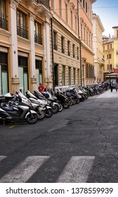 Rome, Italy -June 10, 2016:  Numerous scooters lined up on a small roadway in Rome, Italy