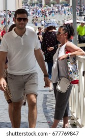 Rome, Italy - June 10, 2017: Tourists walking around the Vatican in Rome Italy.