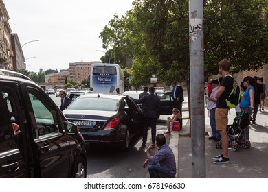 Rome, Italy - June 10, 2017: People at a bus stop in Rome, Italy.