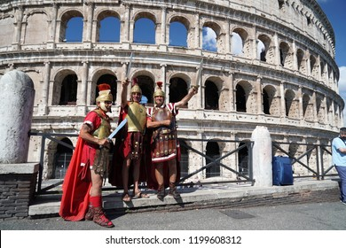 ROME, ITALY - JUNE 10 2018 - gladiators ready for Tourists taking pictures and selfies at colosseo with smartphone
