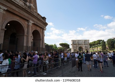 ROME, ITALY - JUNE 10 2018 - Tourists taking pictures and selfies at colosseo with smartphone
