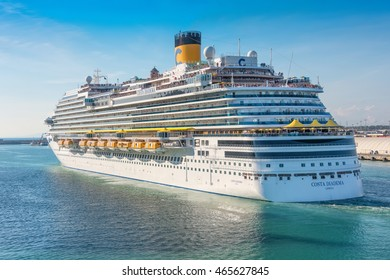ROME, ITALY - JUNE 10,2016:  Passengers aboard the Costa Diadema cruise ship gather on deck for the departure from the port of Rome, Italy.