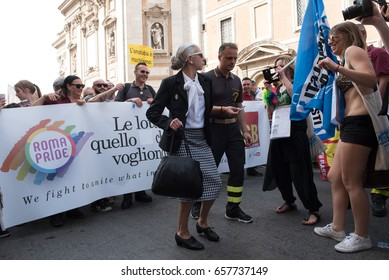 Rome, Italy june 10th 2017. Colorful people and funny woman transvestite on the street during gay pride parade
