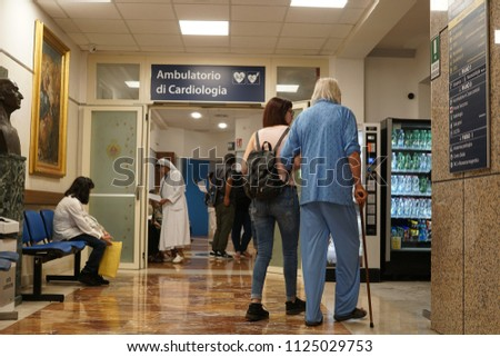 Rome, Italy - June 11, 2018: People patients in the waiting room of a cardiology clinic (Italian: ambulatorio di cardiologia)