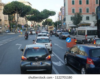 Rome, Italy - June 12, 2018: Cars, scooters and taxis along a central street in the historical center of Rome