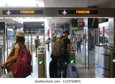 Rome, Italy - June 12, 2018: Back turned people on the railway platform to Rome's Fiumicino Leonardo Da Vinci Airport