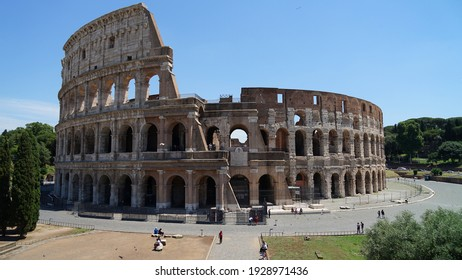 Rome, Italy - June 12 2020: Aerial view of ancient Roman amphitheater and gladiator arena Colosseum, heart of Roman Empire, famous tourist landmark, guided tour concept