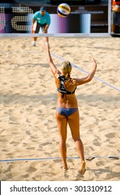 ROME, ITALY - JUNE 15 2011. Beach volleyball world championships. England player Denise Johns serve during a match