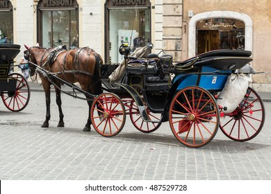 ROME, ITALY - JUNE 15, 2015: Horse Cabs Waiting  for customers  on the Piazza di Spagna. Rome. Italy