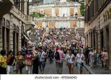 ROME, ITALY -JUNE 15, 2015: Visitors at the Spanish Steps on June 15, 2015 in Rome, Italy.Built in 1723-1725 by a design of the architect Francesco de Sanctis and financed by French diplomat Etienne