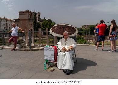 ROME, ITALY - JUNE 15 2019 - Pope John Paul II lookalike. A sosia acting like the famous polish pope.