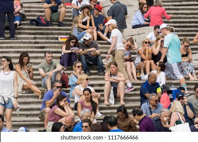 ROME, ITALY - JUNE 16, 2018: Tourists at the Spanish steps in the Piazza di Spagna in Rome. Spanish stairs is famous touristic destination in Rome.