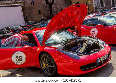 ROME, ITALY - JUNE 18, 2014: Red italian supercar Ferrari with open hood / trunk with umbrellas on exhibition at Republic Square (Piazza della Repubblica), Rome, Italy.