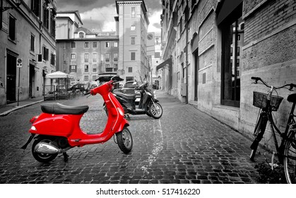 Rome, Italy - June 18, 2016. Small red motorbike on roman street, Italy