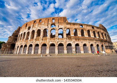 ROME, ITALY - JUNE 2014: Tourists visit Colosseum. The city attracts 15 million people annually.