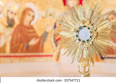 Rome, Italy - June 2015 - Adoration monstrance with the Blessed Sacrament on the altar with copy space for text