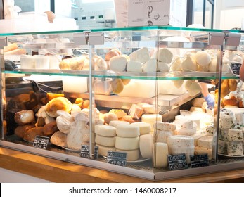 Rome, Italy - June 21, 2014: Customers shopping at Eatly, an  Italian food hall comprising a variety of restaurants, food and beverage counters, bakery, retail items, and a cooking school.