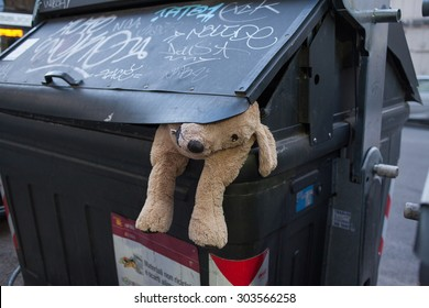 ROME, ITALY - JUNE 22, 2015: Soft toy in a rubbish bin.