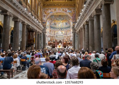 Rome, Italy - June 23, 2018: Panoramic view of interior of Basilica of Santa Maria in Trastevere (Our Lady in Trastevere) is a titular minor basilica in the Trastevere district of Rome