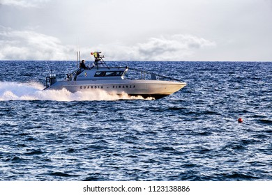 Rome; Italy - June 25; 2018: Patrol boat of italian Guardia di Finanza patrols Rome s  sea. The Italian Guardia di Finanza is an integral part of the Armed Forces of the State.