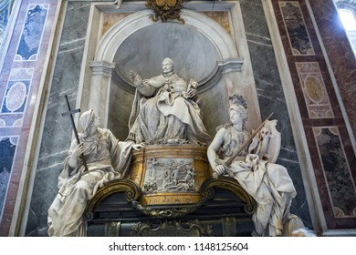 Rome Italy June 27 2015 : Papal statue and sculpture inside St Peter's Basilica, Rome