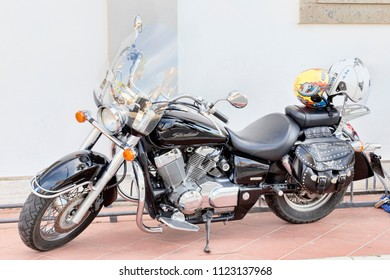 Rome, Italy - June 27, 2018: Beautifull custom motocycle Honda Shadow 750 parked on the seafront in Rome. Produced in Japan by Honda since 1988.