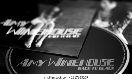 Rome, Italy - June 28, 2019: CD covers and inserts by singer-songwriter, stylist, record producer and British guitarist AMY WINEHOUSE. considered the forerunner of the new generation of white soul
