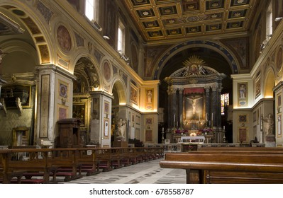 ROME, ITALY -  JUNE 29, 2017: San Lorenzo in Lucina ancient Roman basilica dedicated to St. Lawrence deacon and martyr, the baroque altar in the central nave.