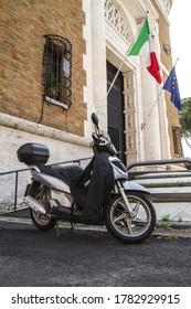 ROME, ITALY - JUNE 3, 2019: Honda SH150i motor scooter in front of ANMIG (Associazione Nazionale fra Mutilati e Invalidi di Guerra) entrance, Rome, Italy.