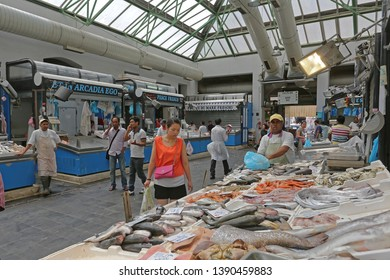 Rome, Italy - June 30, 2014: Shoppers and Fishmongers at Fish Market Near Termini Station in Rome, Italy.