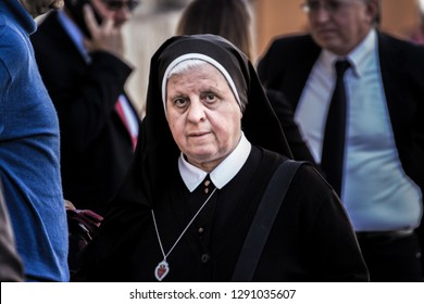 ROME, ITALY - JUNE 30, 2017: Nun walking in the streets of Rome at the Vatican.