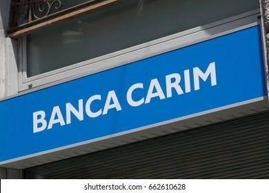 Rome, Italy - June 6, 2017: Carim bank branch signboard. Banca Carim – Cassa di Risparmio di Rimini SpA is an Italian saving bank based in Rimini, Emilia Romagna, only active in the area around Rimini