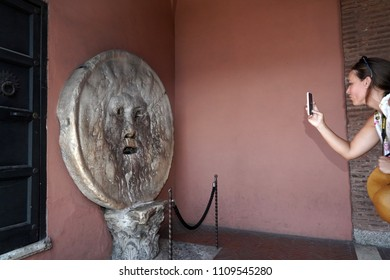 ROME, ITALY - JUNE 8 2018 - The mouth of truth is attracts visitors who audaciously stick their hand in the mouth the legend is said to bite off hands of liars