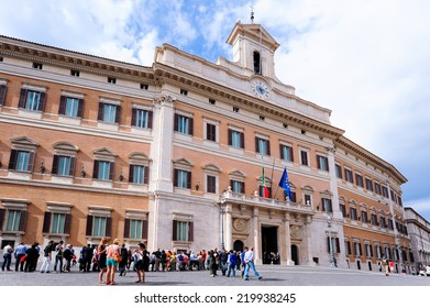 ROME, ITALY - JUNE 9 2013: Palace of the Italian Government Montecitorio during the day with visitors.