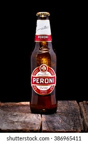 ROME, ITALY. MAR 06. One bottle of italian beer on wooden table. EDITORIAL