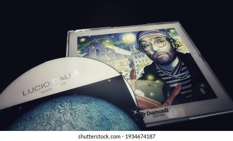 Rome, Italy - March 05, 2021, dvd 12000 moons - Lucio Dalla. The compilation, box set with cover by Milo Manara, includes three discs that include unreleased tracks Stella, Sottocasa, Dark Bologna.